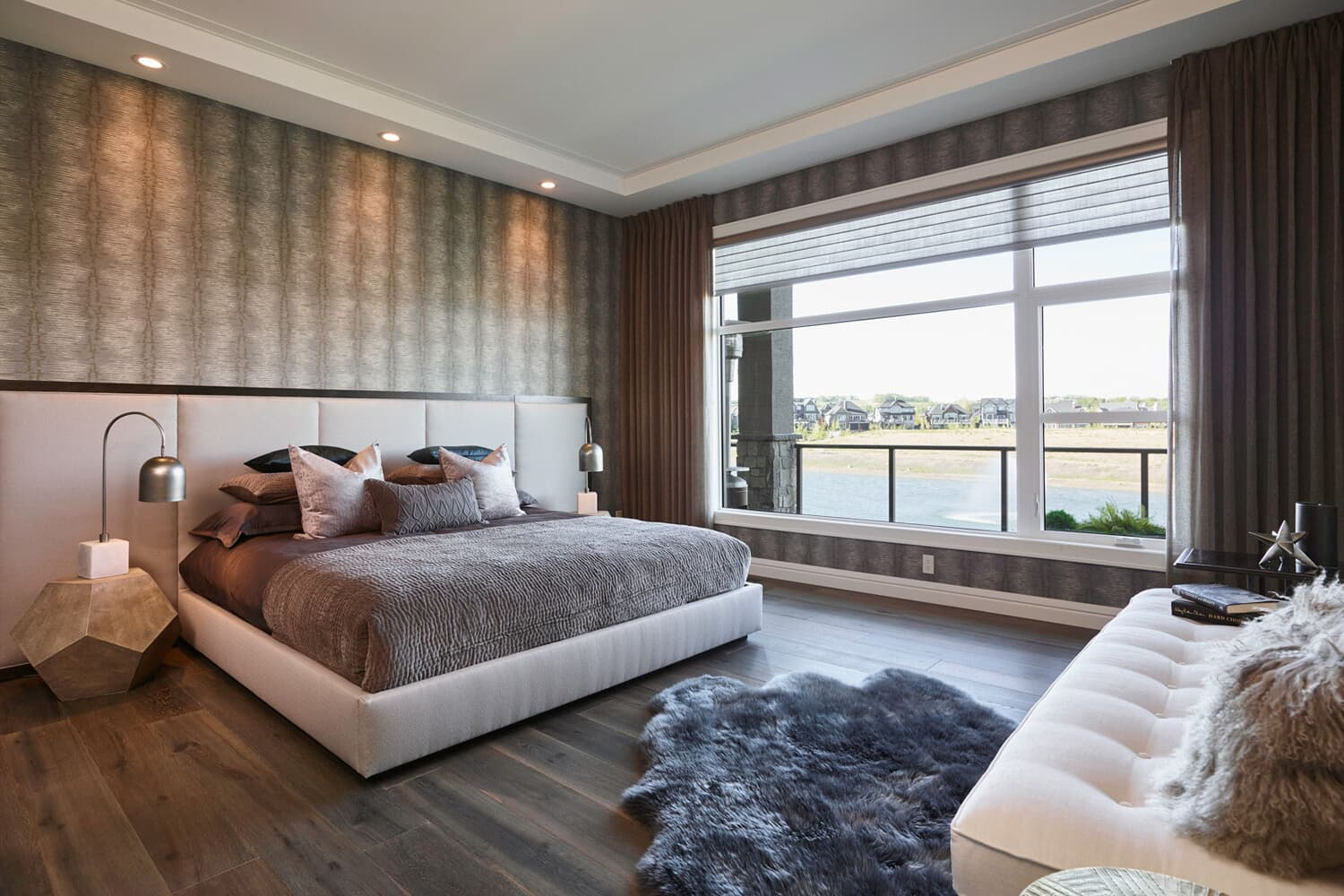 the master bedroom in the carmini 2 home in cranstons riverstone