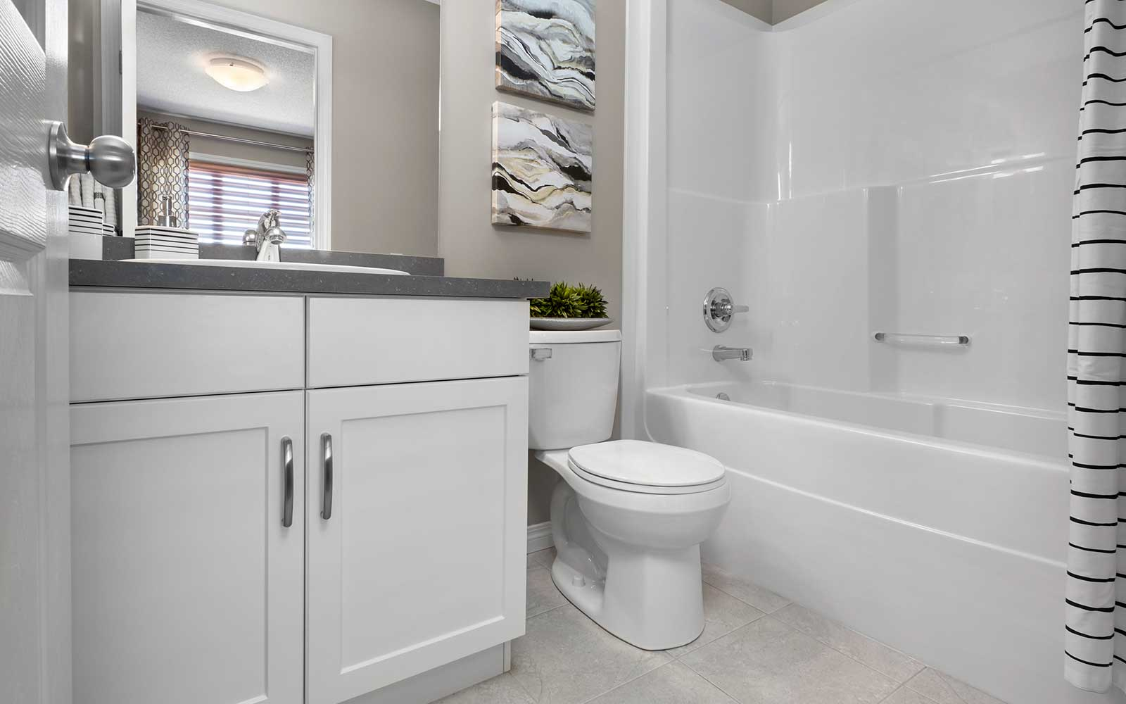 A bathroom in the Van Gogh townhome model by Brookfield Residential in Edmonton.
