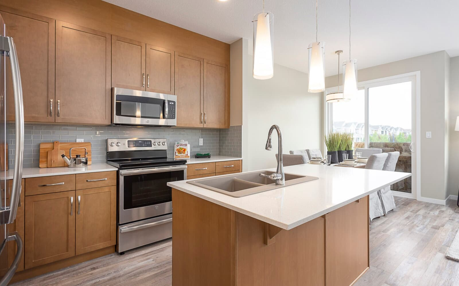 Kitchen view of a Brookfield Residential duplex in The Orchards, Edmonton, Alberta.