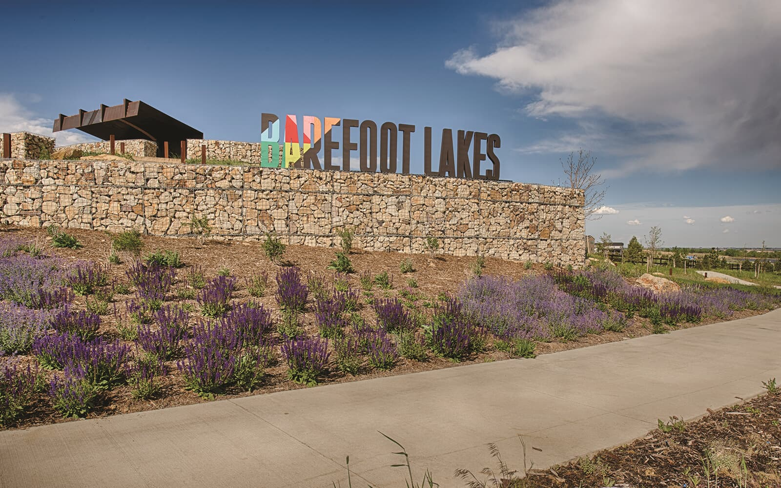 Lifestyle-Photo-Entry-Signage-Sunset-Pavillion-Barefoot-Lakes-Denver-Colorado