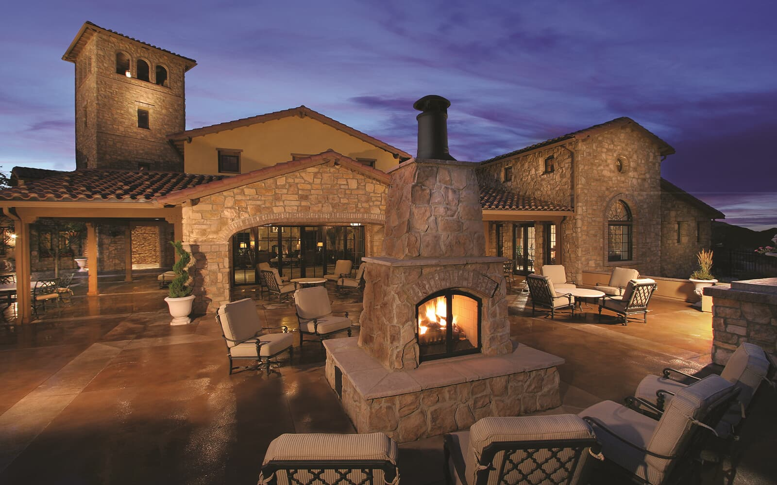 Lifestyle-Photo-Community-Retreat-Fireplace-Patio-Tower-Dusk-Solterra-Denver-Colorado