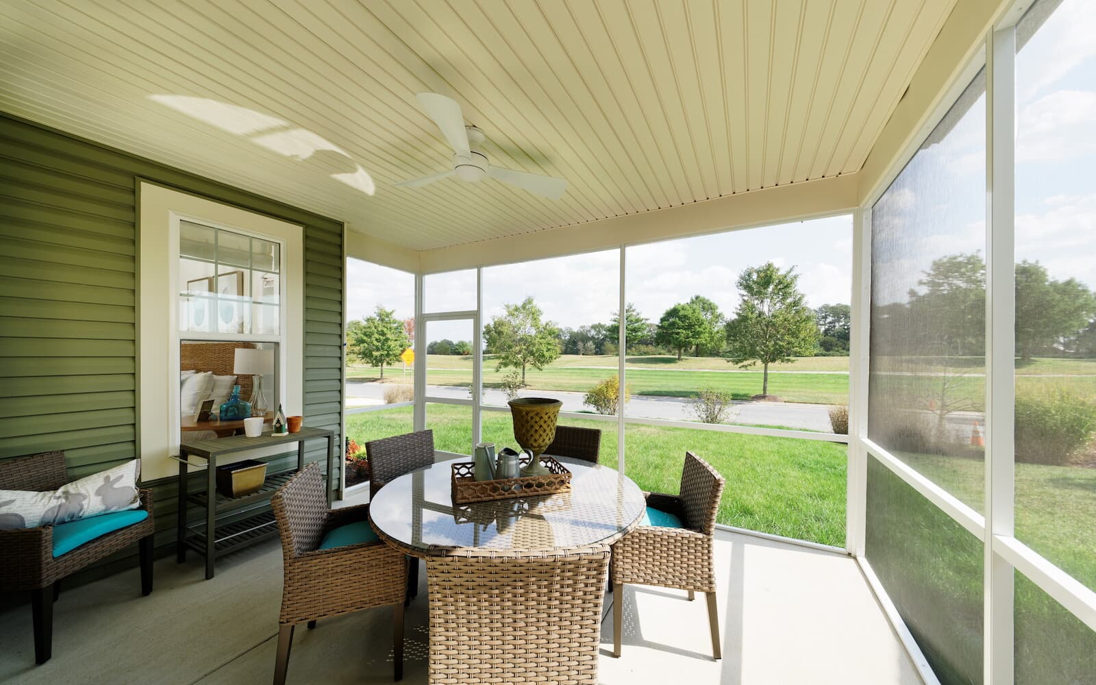 A screened porch in the Picasso at Heritage Shores in Bridgeville DE