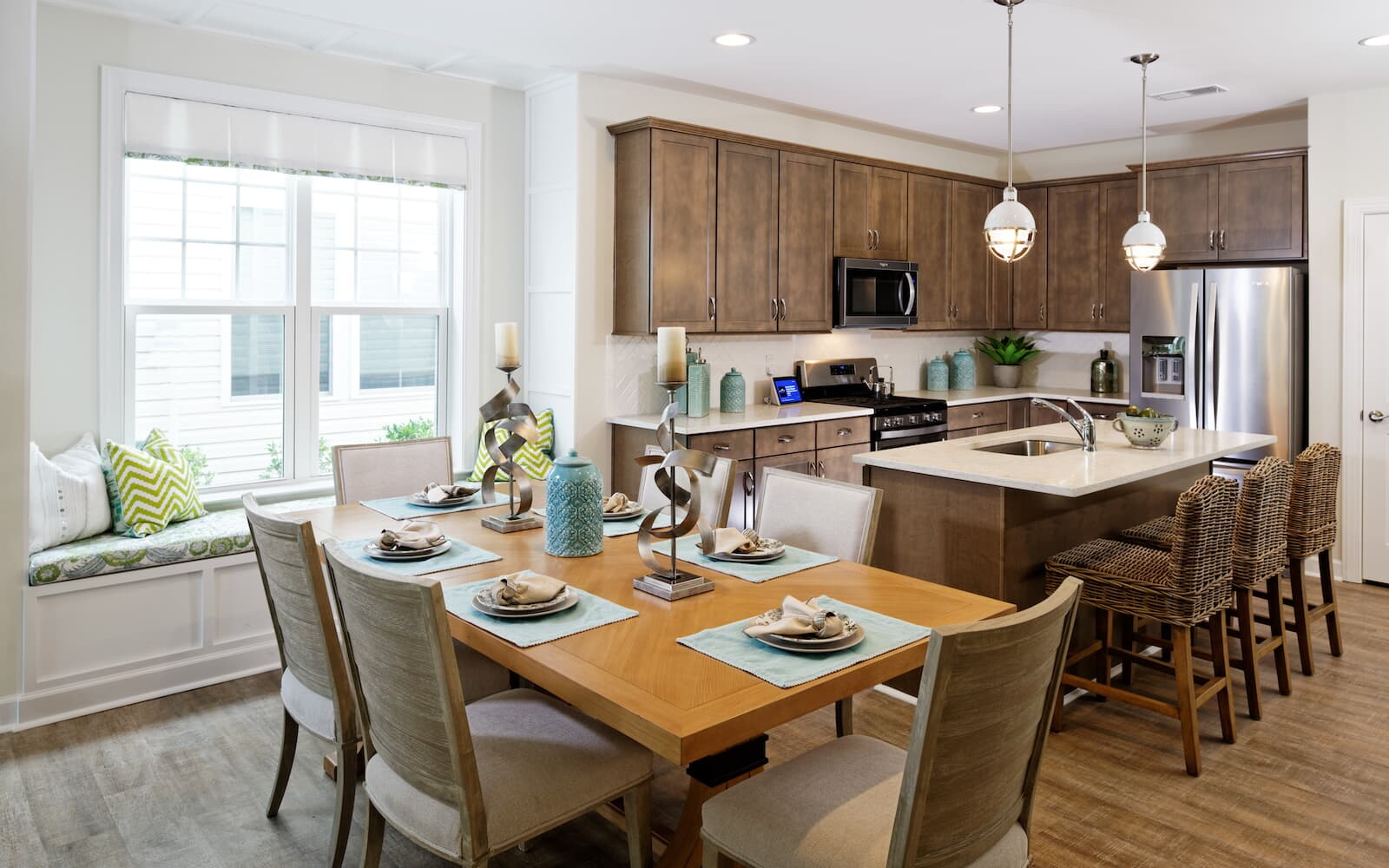 The dining room is open to the kitchen in the Picasso at Heritage Shores