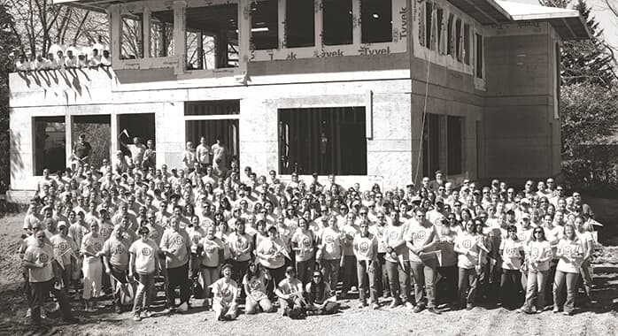 A black and white photo of Carma employees before becoming Brookfield Residential
