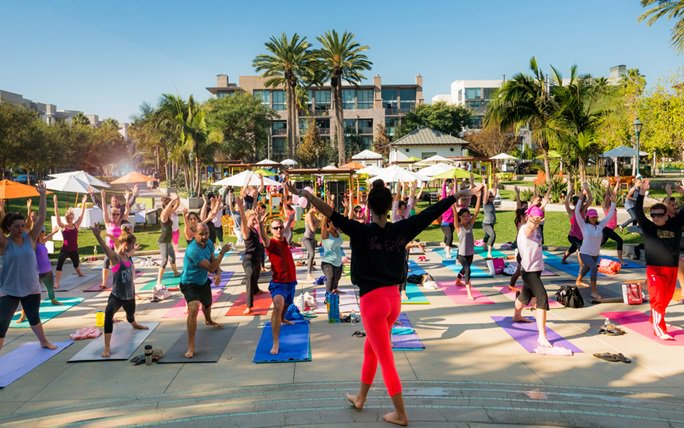 People doing yoga within Playa Vista community in Los Angeles, CA | Brookfield Residential