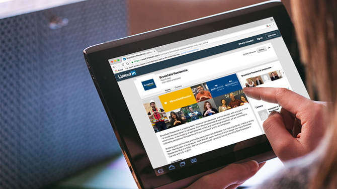 A person scrolling through an ipad viewing the Brookfield Residential code of conduct