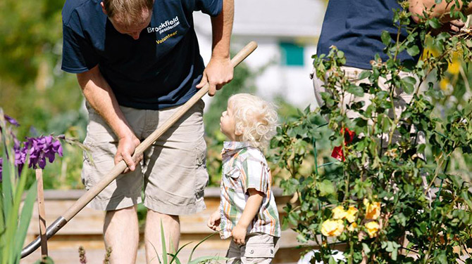 Man and child gardening Brookfield Residential
