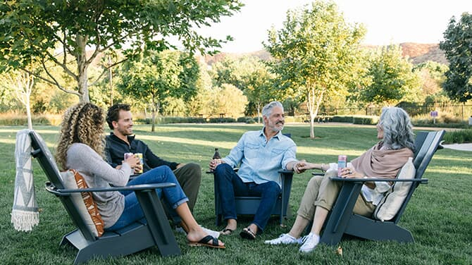 Friends Sitting on the Lawn | Brookfield Residential
