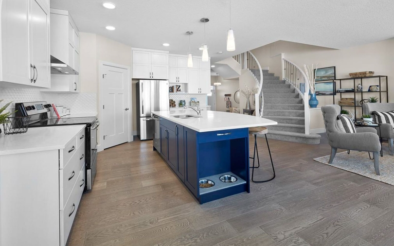 Robson Kitchen, Great Room and Stairway at Paisley | Heritage Valley in Edmonton, Alberta | Brookfield Residential