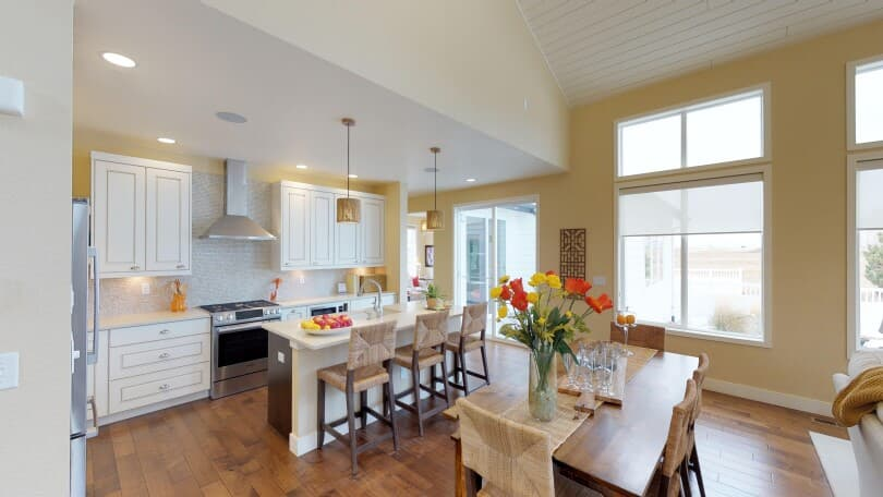 Interior view of the dining area and kitchen in the Freestyle 6 floor plan at Brighton Crossings, Colorado