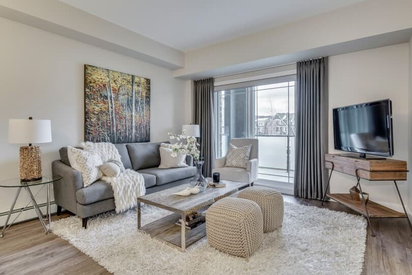 Cozy great room in the Nelson condo at Regatta in Auburn Bay, Calgary by Brookfield Residential