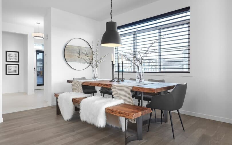 Elegant Dining Table with sheepskin throw at Edgemont in Edmonton, AB