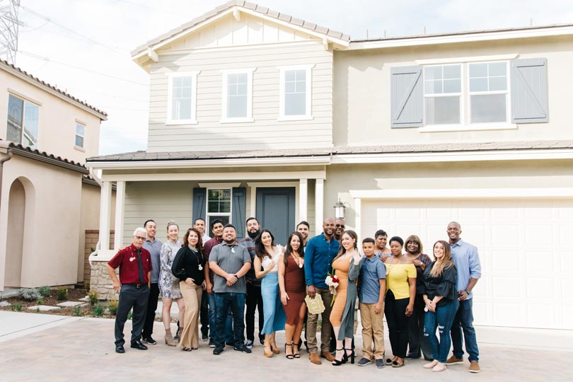 Family in Front of New Home | Poppy at New Haven in Ontario Ranch, CA | Brookfield Residential