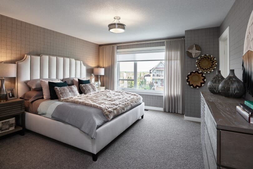 Master bedroom in a home at Cranston's Riverstone in Calgary, AB by Brookfield Residential