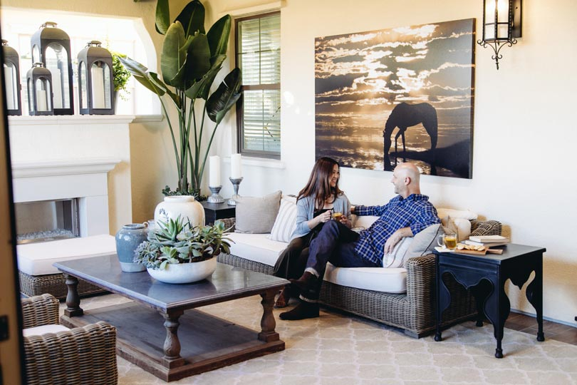Couple on Deck Residence 2 | Beverly at Eastwood Village in Irvine, CA | Brookfield Residential