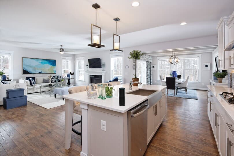Interior view of the kitchen and great room in  the Kensington plan inside the Avendale community in Bristow VA