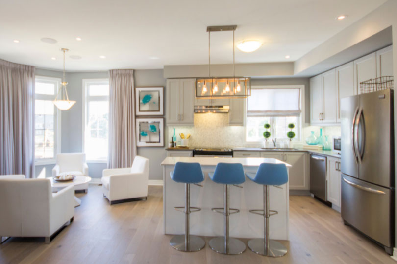 Open-concept kitchen and breakfast area in a Willow Glen model home.