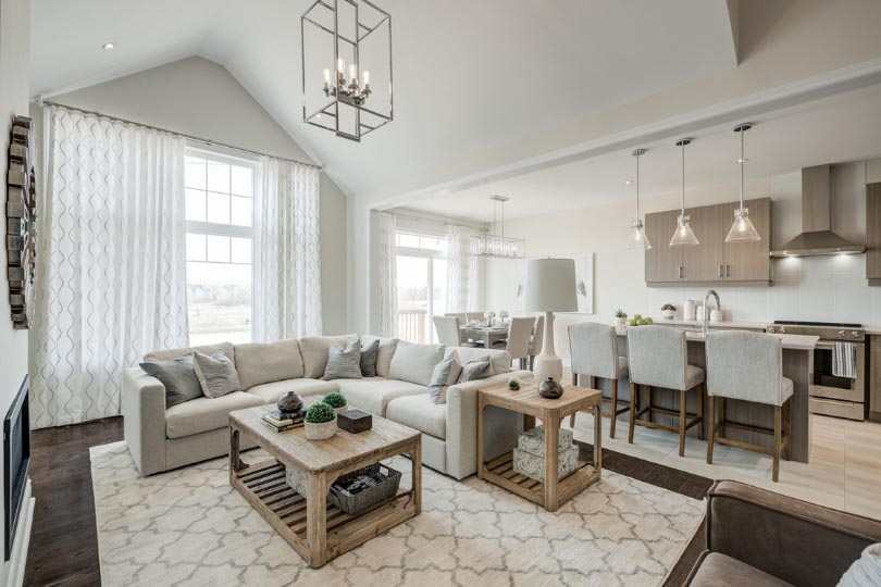 Open-concept family room and kitchen in a Pathways model home.