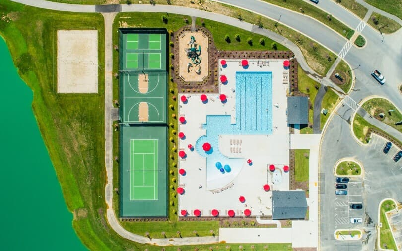 Aerial overview of the Hamlet Clubhouse pool and courts at Two Rivers in Odenton, MD