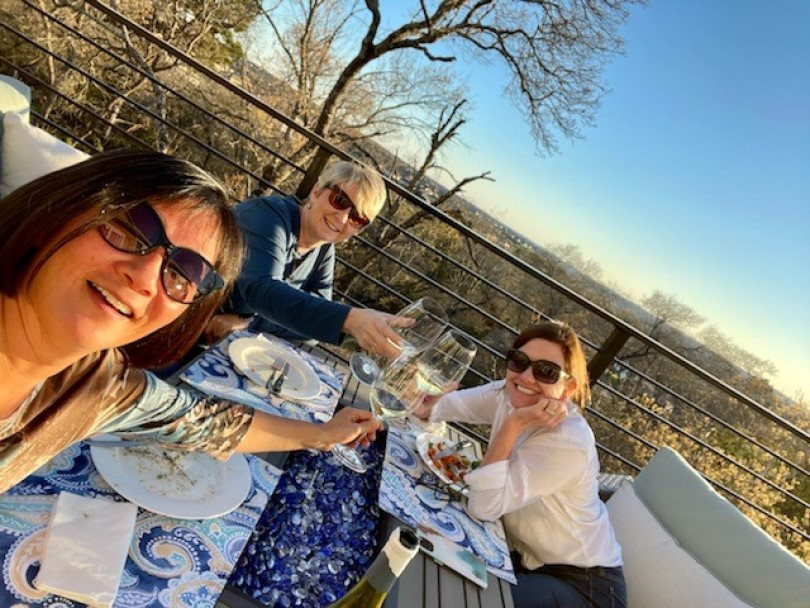 Zarina, Lou, and Amy enjoying happy hour on the deck at the Cottages at Crystal Falls in Austin, TX