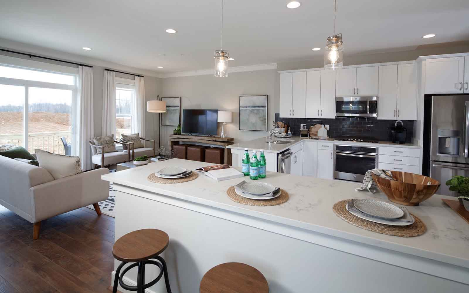 The kitchen and living room in the Aurora at Bradford s Landing in Silver Spring MD