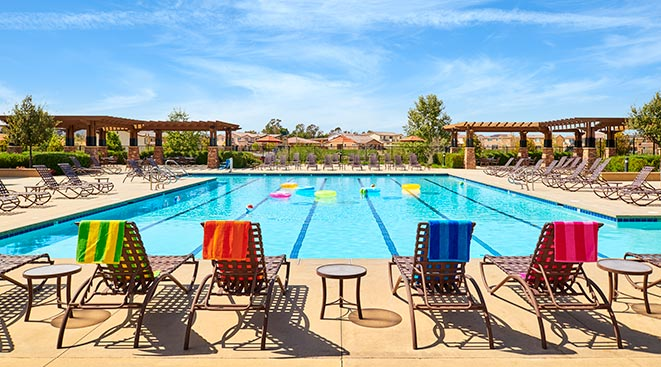 Private outdoor pool surrounded by luxury homes within Spencers Crossing community in Murrieta, CA | Brookfield Residential
