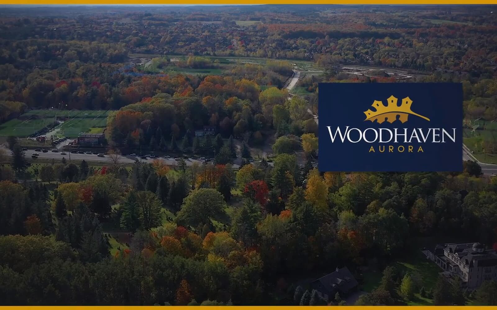 Woodhaven logo and aerial footage surrounded by forest at Woodhaven in Aurora, Ontario.