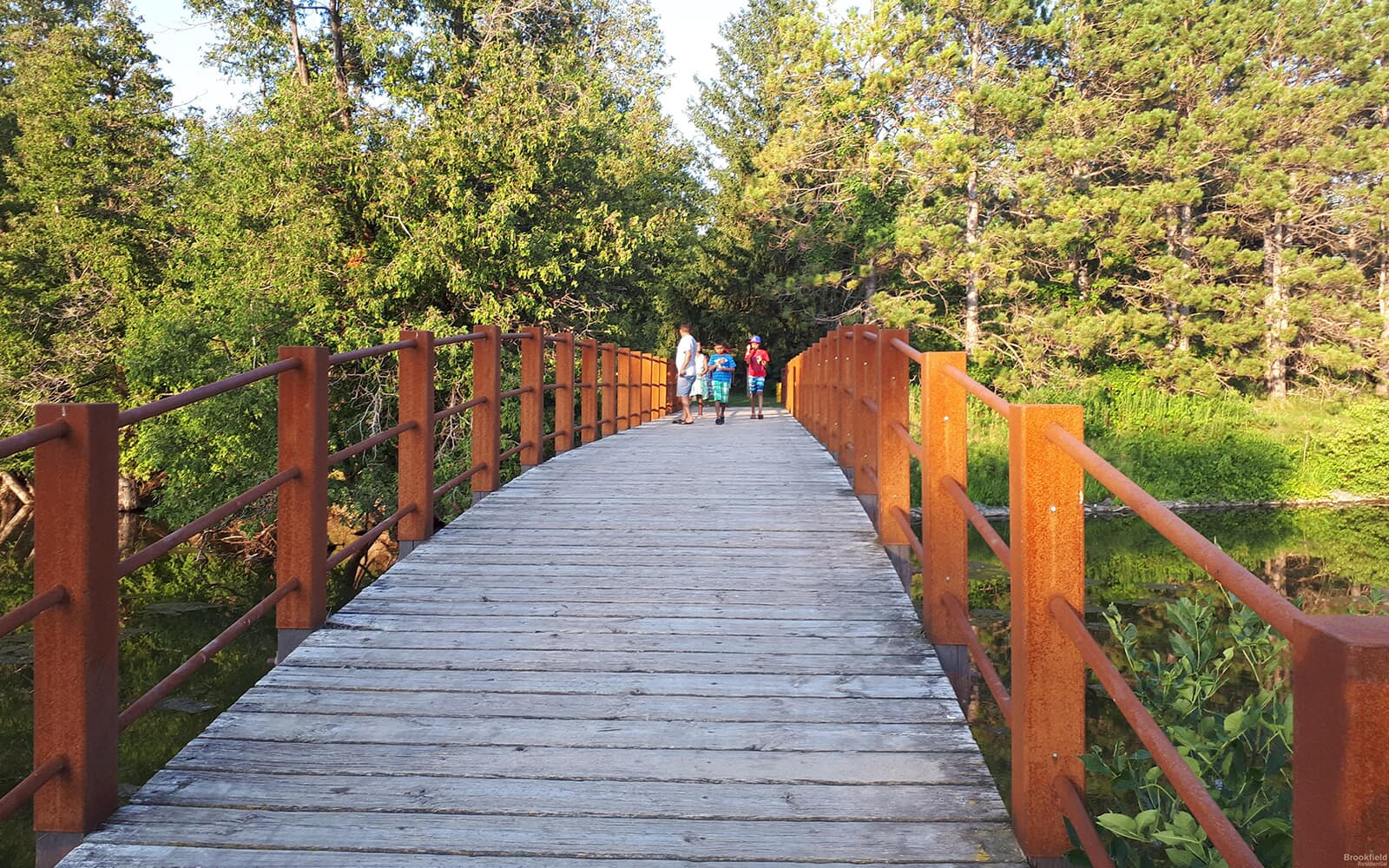 Bridge at Park with Kids and Adult Walking in Baxter, Ontario.
