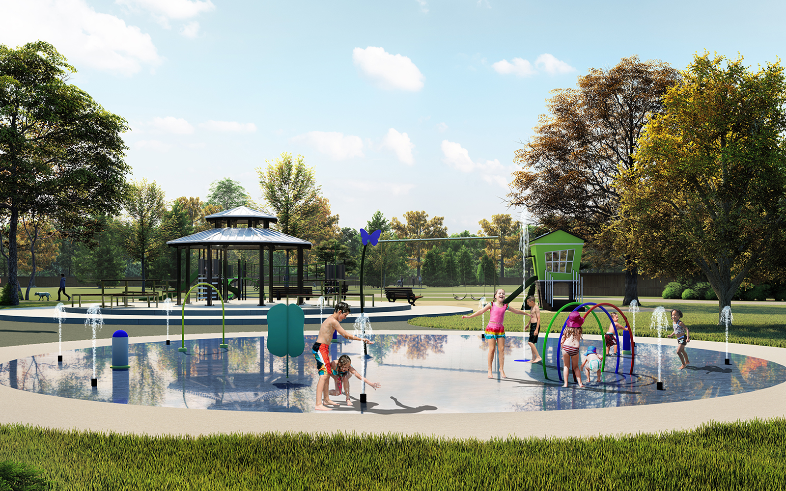 Children playing at a splashpad in the park at the Heartland community in Baxter by Brookfield Residential