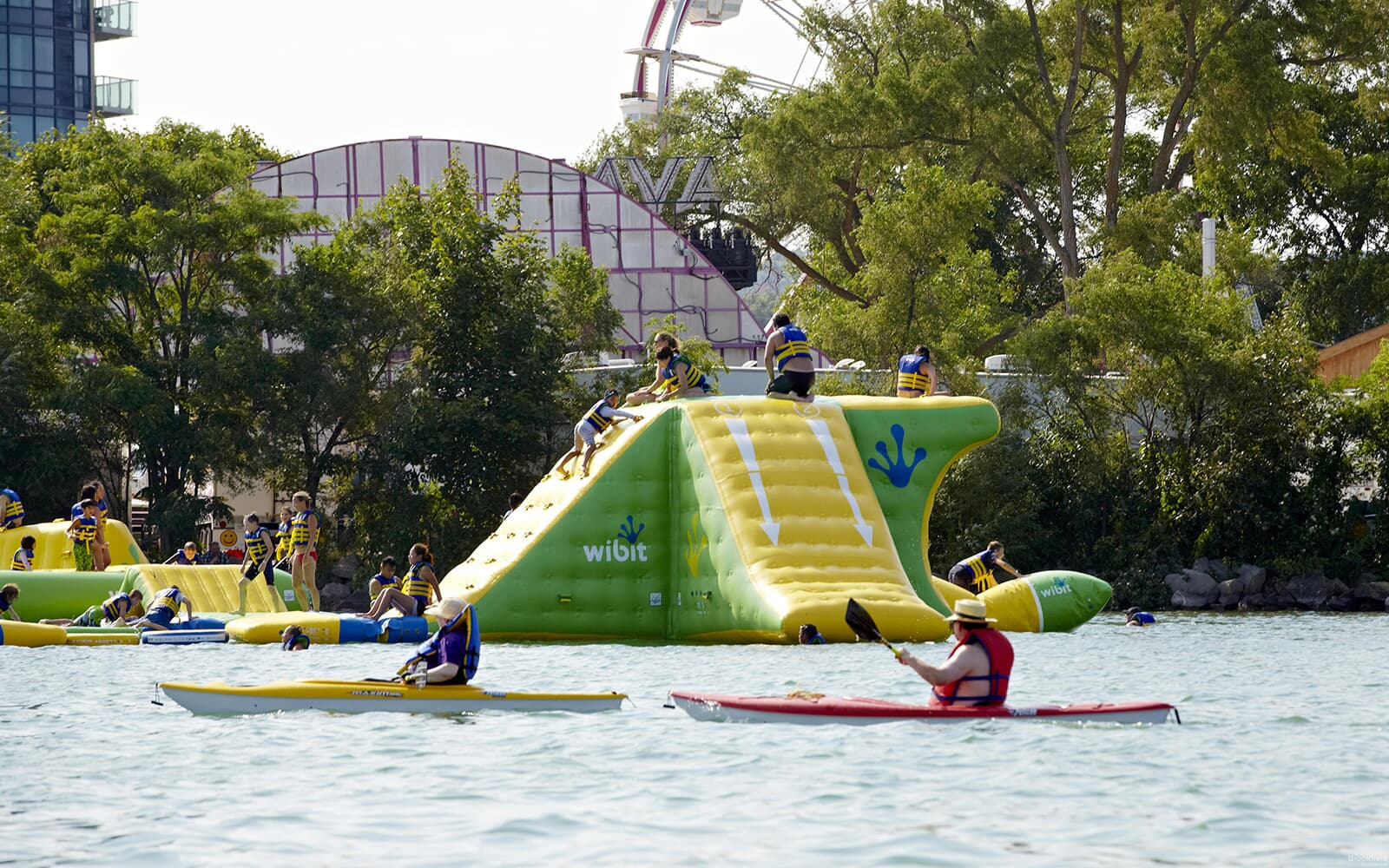 Inflatable Bouncy Castle on Water with Kids in Baxter, Ontario.