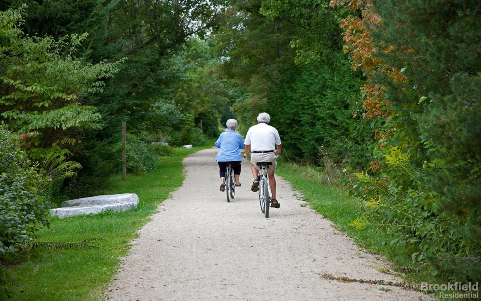 Couple Riding Bicycles From Behind at Park in Caledon East, Ontario.
