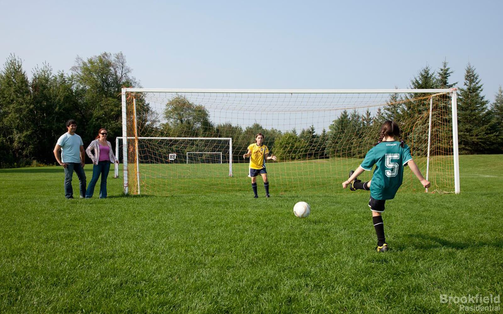 Kids are playing soccer outdoor in Caledon East, ON