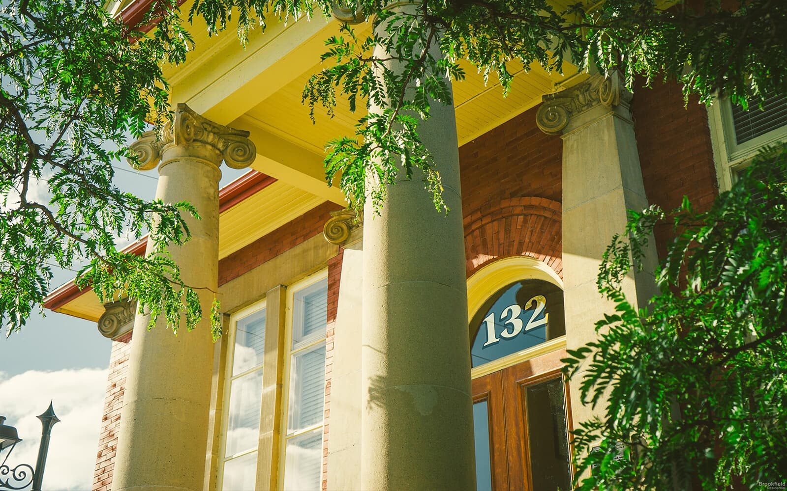 Old Building With Columns Surrounded by Branches in Whitby, ON