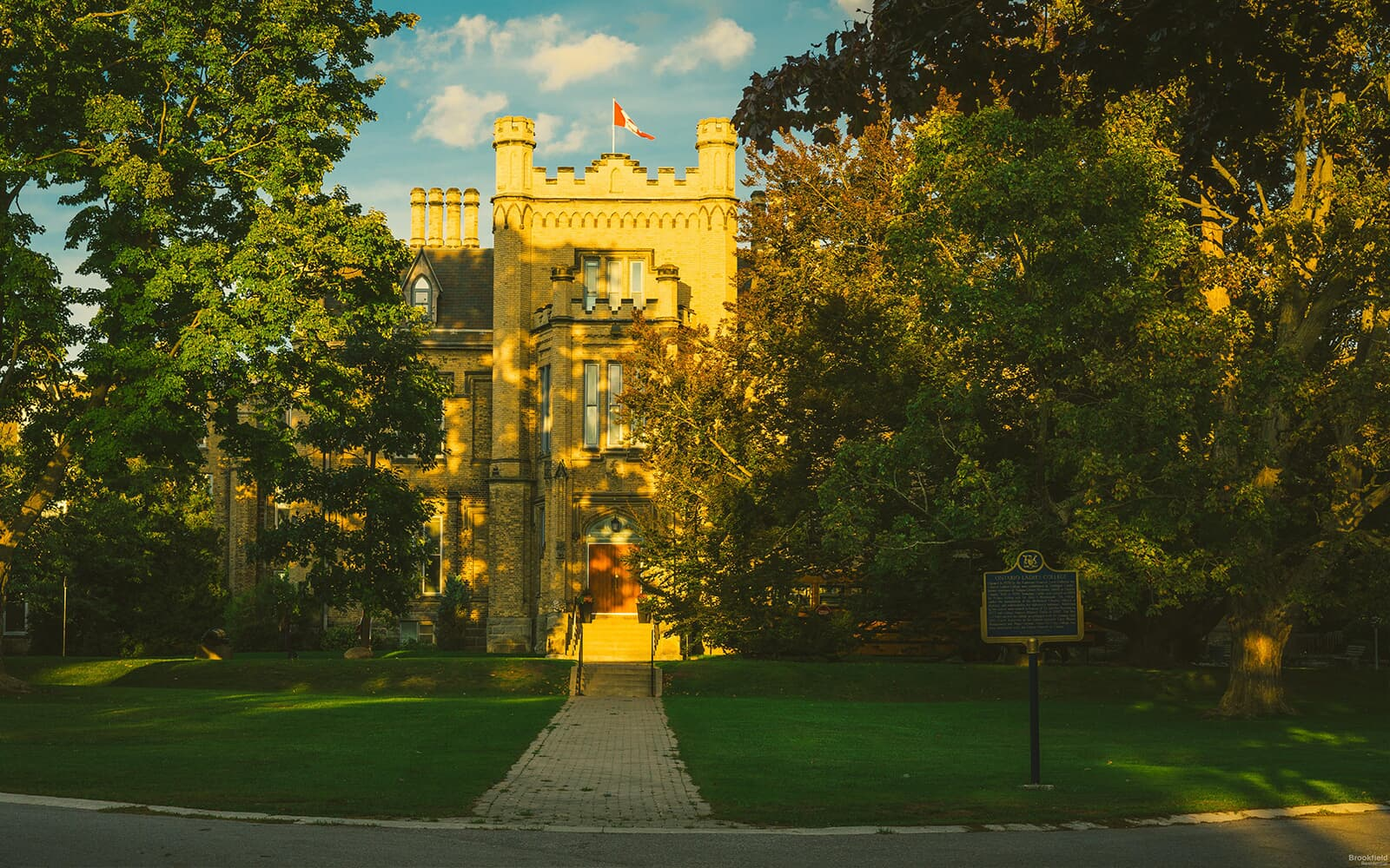 Ontario Ladies College Front Entrance Surrounded by Trees in Whitby, ON