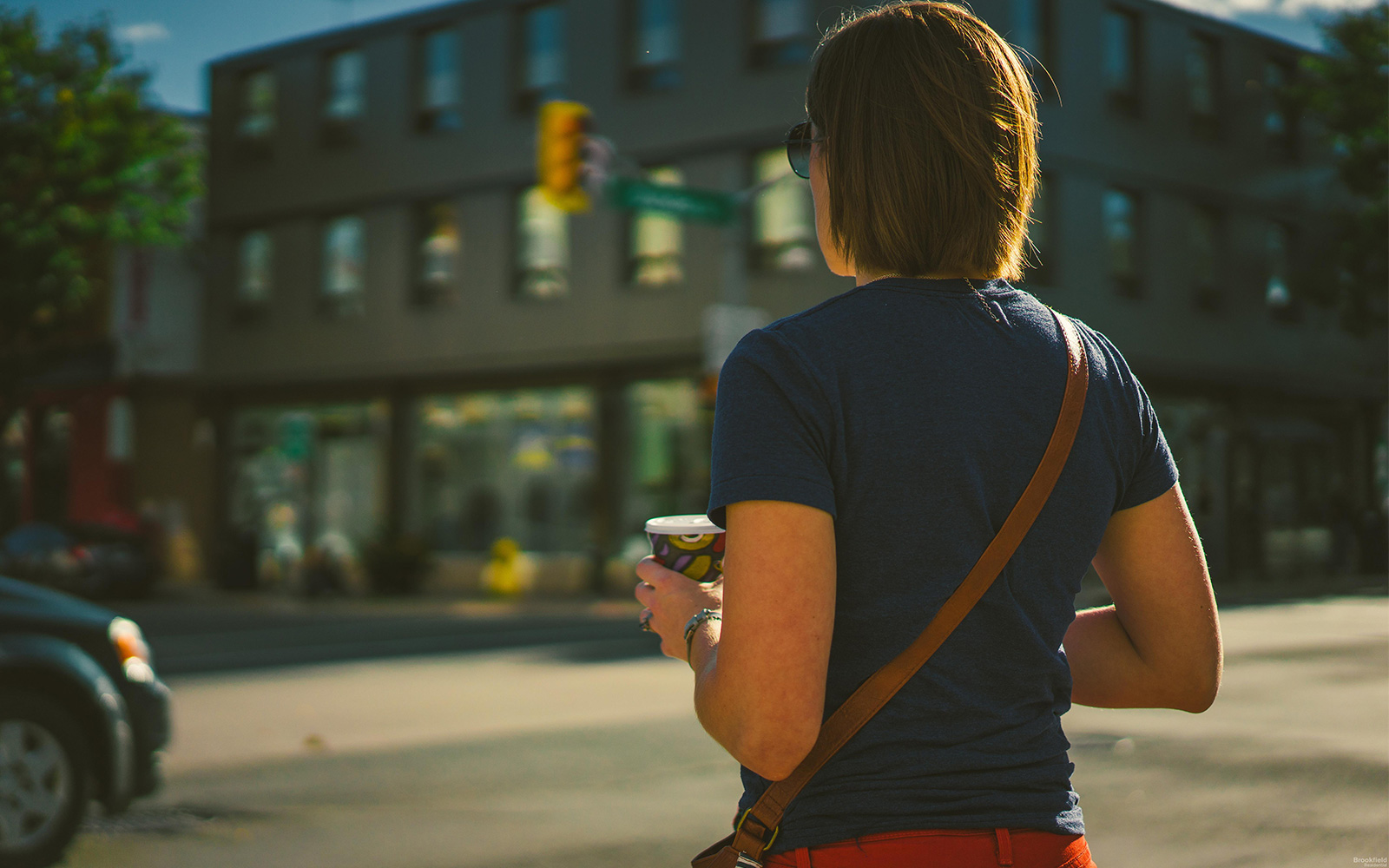 Woman Holding Coffee on Street in Whitby, ON