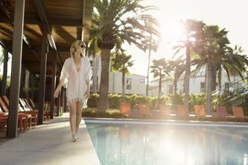 Woman by a pool at the resort at Playa Vista in Los Angeles, CA | Brookfield Residential