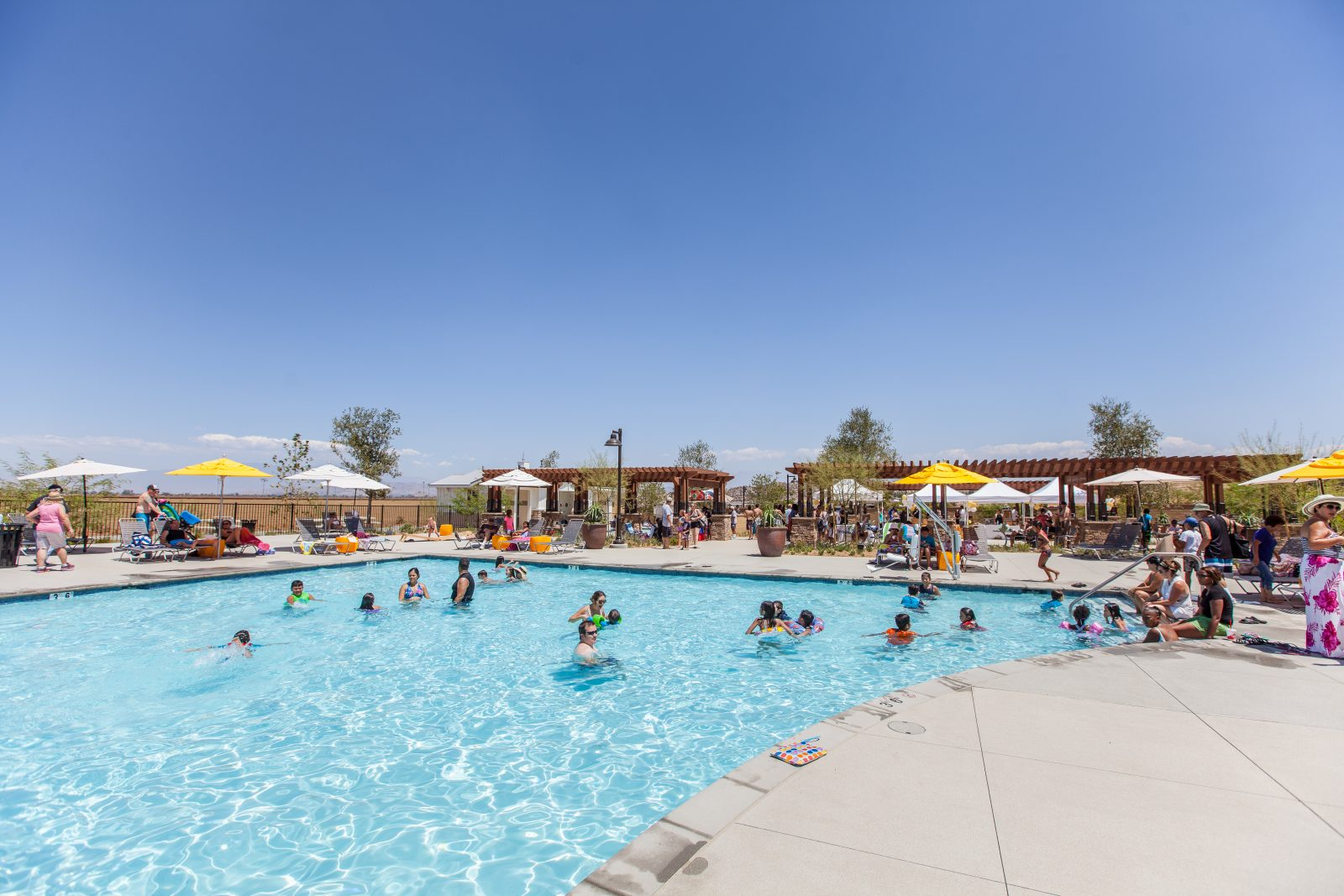 Children in a pool at Audie Murphy Ranch in Menifee, CA | Brookfield Residential
