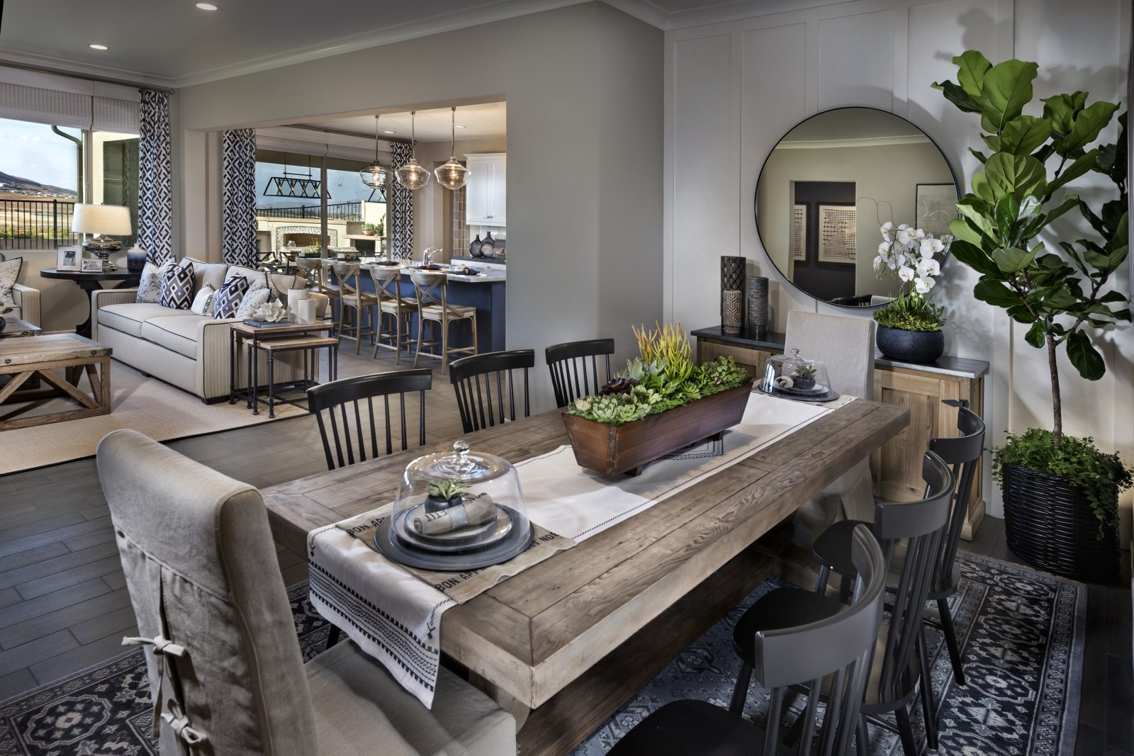 Dining room with rectangular grey wood table at Savannah in the community of Auide Murphy Ranch in Menifee, CA