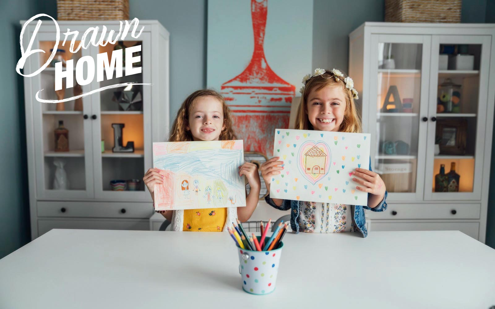 Two girls show their drawings | Brookfield Residential Drawn Home