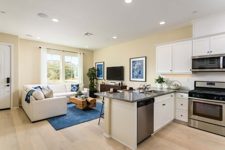 Kitchen to Great Room Residence 1 | Flora at the Village of Escaya in Chula Vista, CA | Brookfield Residential