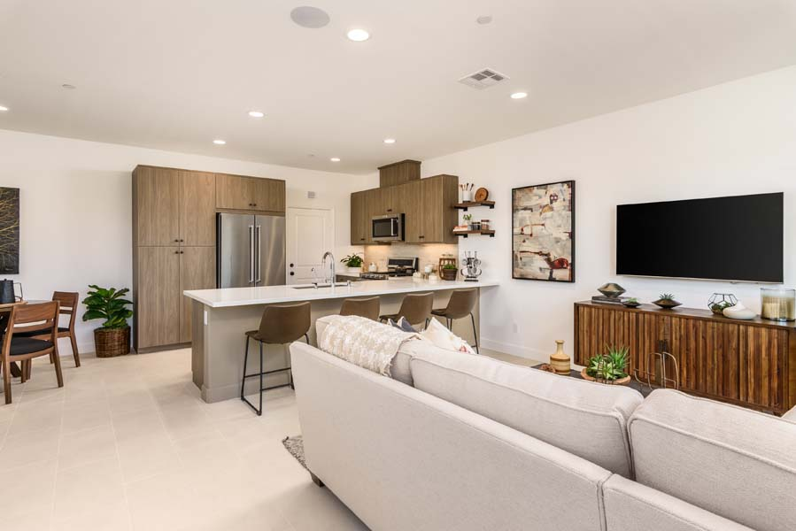 Great Room to Kitchen Residence 2 | Flora at the Village of Escaya in Chula Vista, CA | Brookfield Residential
