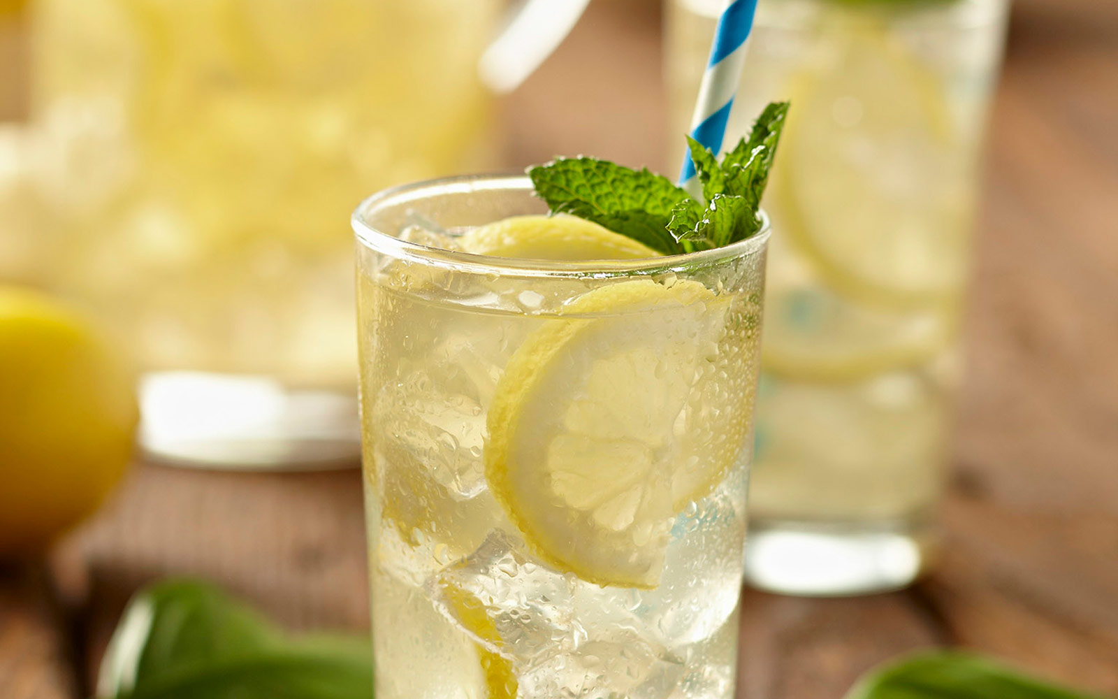 Water glass with lemon slices and mint leaves