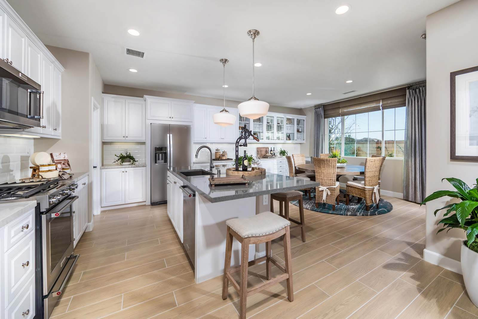 Kitchen Dining Room Residence 3 | Marigold at New Haven in Ontario Ranch, CA | Brookfield Residential