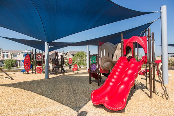 Kids in a park at New Haven in Ontario Ranch, CA | Brookfield Residential