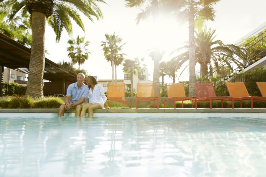 Couple at a pool at Playa Vista in Los Angeles, CA | Brookfield Residential