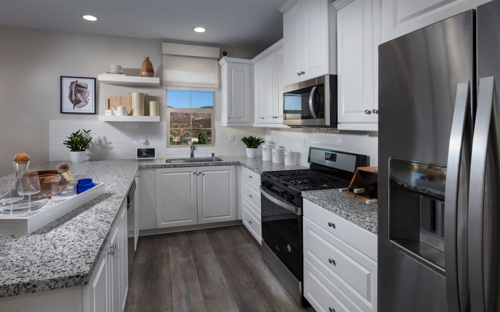 White Modern U Shaped Kitchen in Residence 1 at Latitude at Rancho Tesoro in San Marcos CA