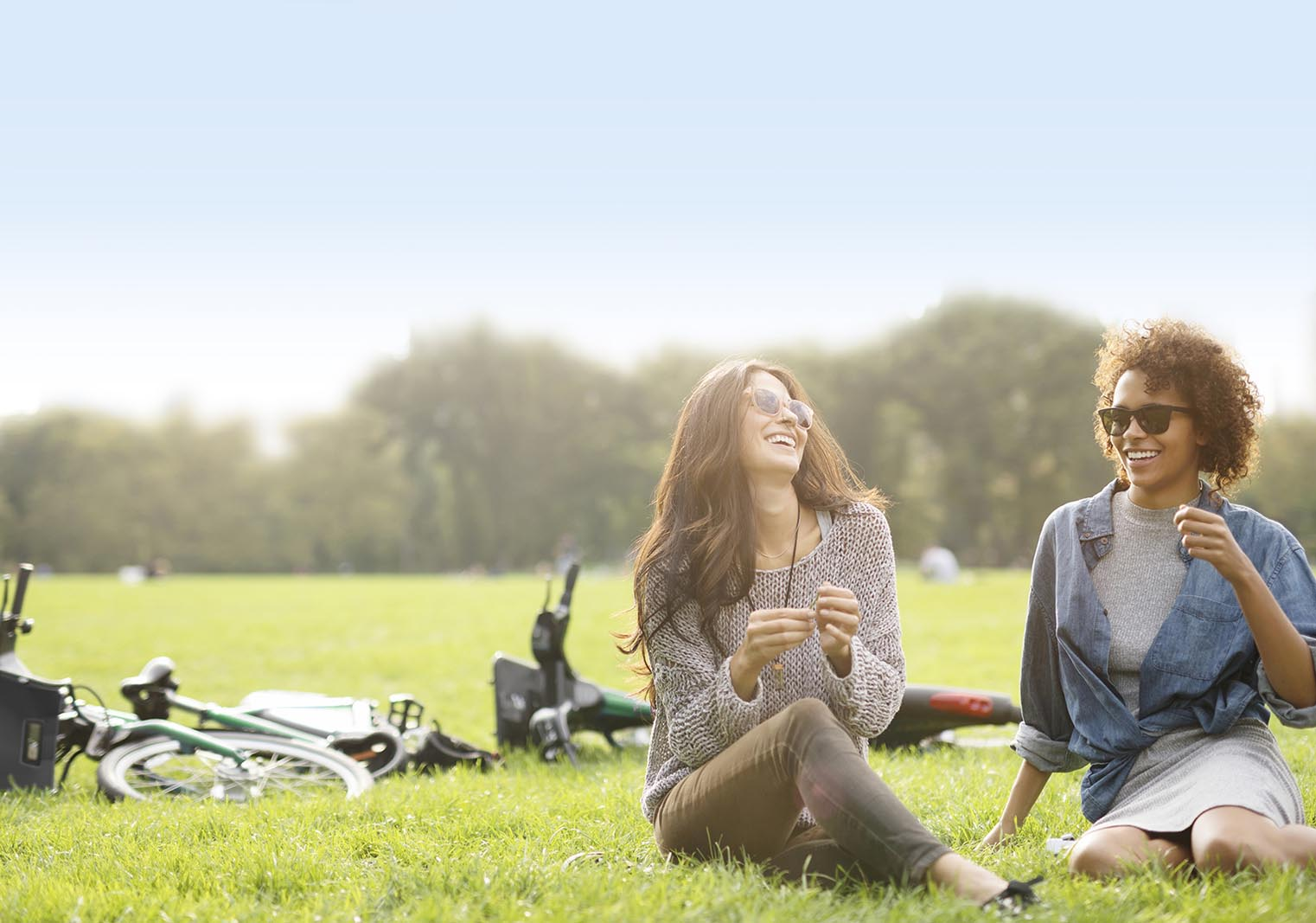 Women on the grass smiling | Bayberry at The Groves in Whittier, CA | Brookfield Residential