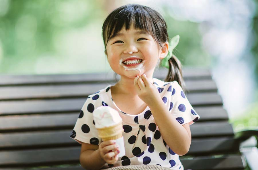 Girl eating ice-cream | The Groves in Whittier, CA | Brookfield Residential