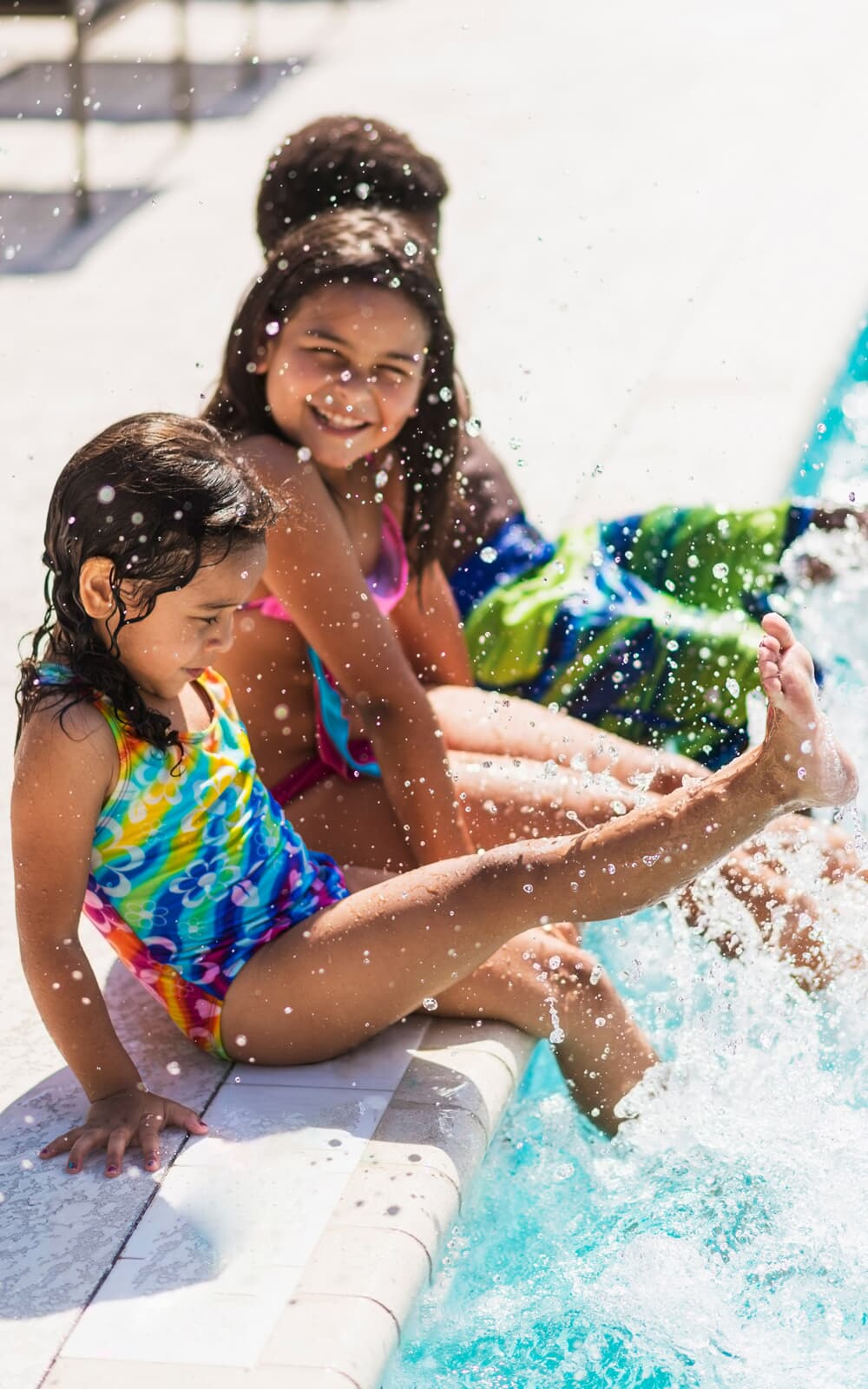 Kids splashing in a pool | The Groves in Whittier, CA | Brookfield Residential