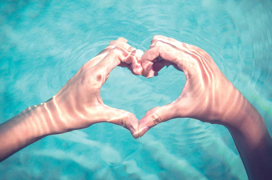 Heart hands in pool | The Groves in Whittier, CA | Brookfield Residential